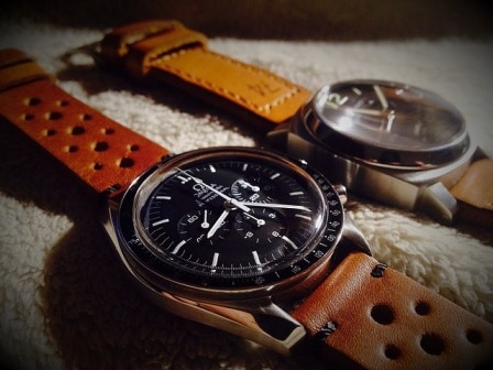 Two Omega watches with brown leather straps